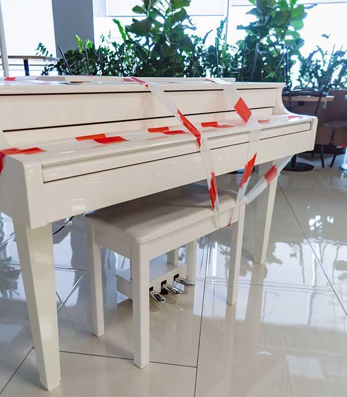 Spezial- und Schwertransporte: Klavier Vorbereitung zum Transport